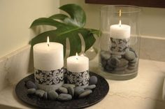 -Decorating our extra bedroom w/white furniture and black/white/bright blue damask print. This is awesome! Simply take fabric / ribbon and wrap around white candles. LOVE this quick & easy craft idea! Bathroom Candles, Bathroom Spa, Candle Wall Sconces, White Candles, Pillar Candles, Diy Candles, Deco Zen, Damask Decor, Decoration Table