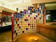 Glass block wall with multi-colored blocks and randomly clipped top edge.