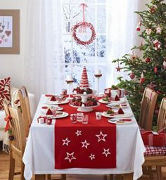 Stars adorn the red runner. Stacked plate centerpiece. Chair decor.