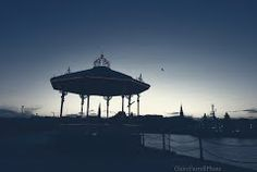 Dun Laoghaire silhouetted at dusk. spot the moon Dusk, Dublin, Gazebo, Outdoor Structures, Silhouette, Sunsets, Moon, The Moon, Kiosk