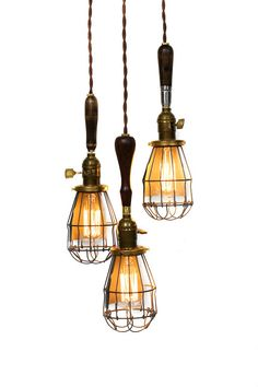 One of a kind chandelier, each light has a different reclaimed wood handle and metal light bulb cage. Vintage style paddle key on/off light