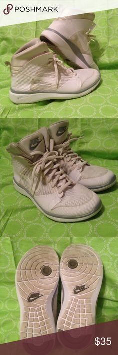 Nike I forgot the name of these, but they are a pair of super light basketball shoe, easy and flexible to move around with, it do have indented mark shown in first photo, the shoe is white so they are dirty, they're in women size 6 Nike Shoes Sneakers