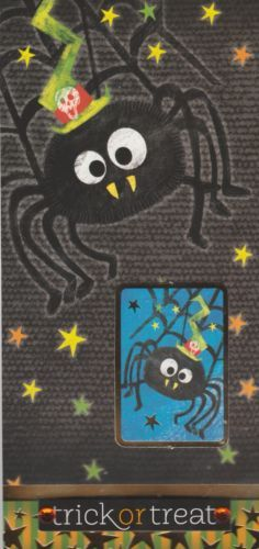 Halloween Handmade Card featuring spider (with fangs and a party hat!) as well as the message 'trick or treat' with orange acrylic gemstones accenting it