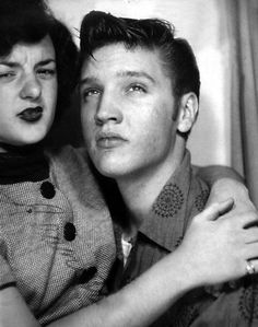 elvis in a photobooth with someone not that happy to be with elvis