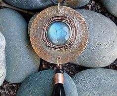 "Halo Pendant  Instructor: Kat Clark Workshop Fee: $35 Sunday, November 6 (1-4pm) OR Wednesday, November 30 (6-9pm) Halo Pendant is inspired by the beautiful Autumn halo moons. Intermediate students will hone their bezel making skills with a combination of clever tricks and tools. Texturing, wire weaving, stone placement, and setting ""tube"" rivets complete the tasks of making this statement pendant. Previous sheet metal experience is required. Materials list."