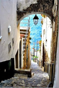 Alleyway leading to the sea in Praiano a town in southwest Italy. It is situated on the Amalfi Coast, between the towns of Amalfi and Positano. Positano, Amalfi Coast, Dream Vacations, Vacation Spots, Capri Italia, Places To Travel, Places To See, Places Around The World, Around The Worlds