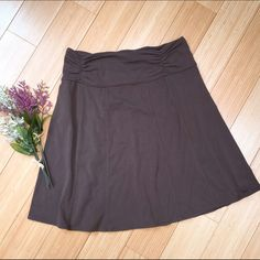 """Athleta knit brown skirt, small petite. Sweet skirt from Athleta. Simple brown knit, elastic waist. This is slightly faded from washing, and is a lighter """"summer brown.""""  Reflected in price. Athleta Skirts Midi"""