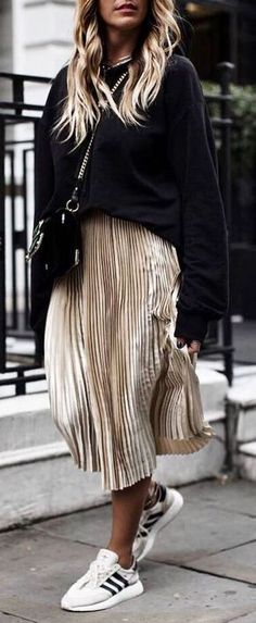 beautiful winter outfit_black sweatshirt golden midi skirt sneakers