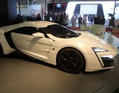 """Expensive supercars have long been common in Europe, by the Lykan Hypersport hopes to make history as """"the first Arabian hypercar."""" Debuted at the 2013 Qatar Motor Show, the Hypersport features an engine with 750 horsepower and a top speed of 245 mph. Plus, with its diamond-crusted LED headlights, there's no hiding this hypercar's over-the-top price tag."""