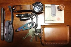 Country Comm••Stainless Embassy Pen + Spyderco••Techno + Wichard••Carabiner w/Atwood••Stainless Fluted Whistle + Veleno Designs••Quantum DD + Atwood••Ti Pest + Veleno Designs••Locator + Kenton Sorenson••Wallet + Vargo••Ti Money Clip + Seiko••Marine Master