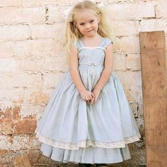 Perfect for your little princess! Shimmering taffeta the color of the winter sky with a lace trimmed cotton underskirt. Features a fully lined bodice.