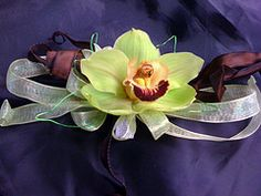 Corsages with flowing long ribbon tails make a big splash.