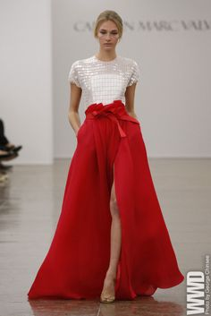 Carmen Marc Valvo RTW Spring 2013  The designer went all-out for his fans this season with oversize peplums and ruffles, blazing colors and glitter galore.