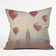 Maybe Sparrow Photography Balloons Over Midtown Throw Pillow | DENY Designs Home Accessories