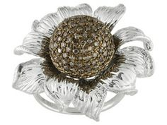 NEW and never seen before!  There is nothing as fresh and eye catching as a floral diamond ring! Perfect for accessorizing your favorite summer outfit for an upcoming wedding, class or family reunion! Loaded with 75ctw Round Champagne Diamonds, it will catch eyes from across the room. It is available in sizes 5-10, and you will be pleasantly surprised by the value!