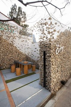 restaurant exterior Deconstructing the gabion wall. Cafe Ato by Design BONO, Seoul store design Café Exterior, Design Exterior, Landscape Architecture, Landscape Design, Architecture Design, Creative Landscape, Landscape Plans, Restaurant Exterior, Restaurant Design