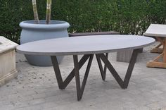Bumble Outdoor Oval Dining Table  with Powdercoated Cast Steel Legs Grey Lava Rock Top or Weathered Teak Top Base: 50