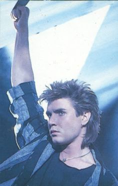Simon le Bon. My grandma made me a jacket like this and I wore it for many years - loved it a ton, even wore shirts and ties with it - so 80s! :)
