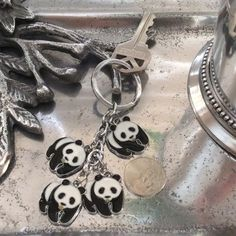 adorable panda keyring  AOPI Mascot Cute!  Cute!!  Cute!!  4 little panda's dangling from your purse or use as a key ring.   Accessories Key & Card Holders