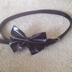 Black Belt with Bow In fantastic condition! Add a bit of fun to your outfit! Measures 38 inches long (not including buckle). Enough holes to be worn around the hips for I'd say size 2 and below on the biggest setting, but definitely can be worn around the waist by larger sizes. Price firm. Thanks for shopping my closet Accessories Belts
