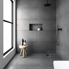 bathroom tiles Would you dare to go dark We love a dramatic space and this bathroom was created with our Evolution Matt Natural Grey tiles. Made from hard wearing porcelain they feature an authentic brushed stone effect finish . Grey Bathroom Tiles, Bathroom Tile Designs, Modern Bathroom Design, Bathroom Interior Design, Bathroom Flooring, Master Bathroom, Shower Tiles, Large Tile Shower, Black Bathroom Floor