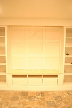 Hemnes built-ins {part one}  chose a total of five pieces, a tv unit, two glass door cabinets with drawers and two bookcases. They totaled about 14 feet in width.