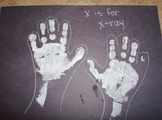 Letter- X- He painted it black and the glued some white bones that I had cut out from paper on in an x shape.  (sorry, no pic!)  Numb...