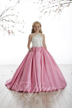 4181117c3 Tiffany Princess 13509 has a sparkling beaded halter neckline with  rhinestones and sequins adorning the bodice. This girl's ball gown has a  full A-line box ...