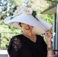 What does a paper crafter wear to the Kentucky Derby? Why an over-sized, handcrafted paper hat decorated with paper orchids.