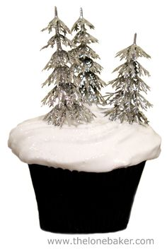 St Clement's Orange and Lemon Cupcake with  Silver Christmas Trees in a Meringue Snow Drift.