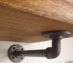 Vintage industrial gas pipe shelf bracket fitting by breuhaus