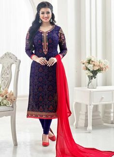 Purple Mischief With Red Contrast Embroidered Churidar Suit Set features georgette top with unique zari and thread embroidery detail with digital printed santoon inner. This set accompanies with matching santoon bottom and nazmine chiffon dupatta. Just style this attire with matching jewellery and heels to look like diva on this Eid festival.