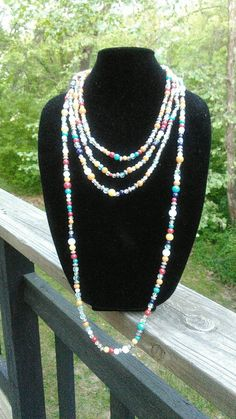 Long beaded multi-colored necklace set by TyeriDesigns on Etsy