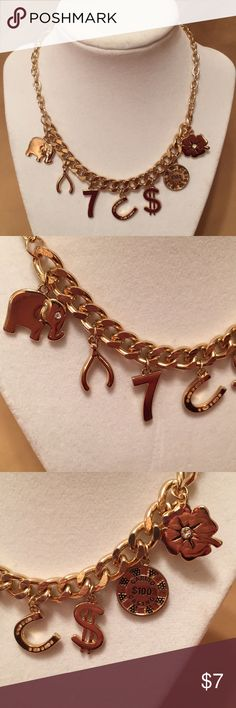 Forever 21 Lucky Charms Necklace This lucky charms necklace is perfect for that trip to Las Vegas or Atlantic City! this whimsical gold necklace is from Forever 21 and features an elephant, wishbone, lucky 7, horseshoe, dollar sign, poker chip, and 4-leaf clover. Lobster clasp with extra links. Sure to bring you some luck whenever you wear it! Forever 21 Jewelry Necklaces