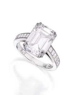 PLATINUM AND DIAMOND RING, TIFFANY & CO. Centered by an emerald-cut diamond