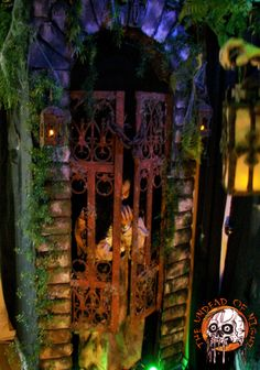 Orphanage entrance , made from cardboard with Rosemary prop behind gate .http://www.halloweenforum.com/members/theundeadofnight-albums.html