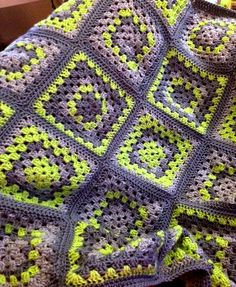 Super cute, super bold granny squares in greys and lime citrine green.    This blanket measures about 52 inches square.    Perfect to add color to