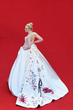 Elle Fanning in a Vivienne Westwood gown on opening night at the 2017 Cannes Film Festival.