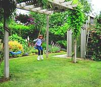 Love the swings and garden shed underneath the pergola.
