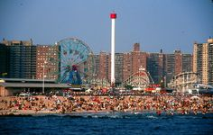 Coney Island, Brooklyn, loved this place when I was a kid. But that's a lot of peeps on that beach!