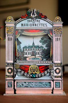 Teatro de miniatura de marionetas de papel.  Teatro de papel basado en los dibujos originales.  Incluye: 1 Teatrino de papel para marionetas sobre una base