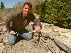 building a fieldstone planting wall