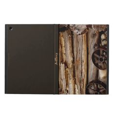iPad Air Case, Rusty Wagon Wheels, Brown Back - The front of this iPad Air case is decorated with our photo of rusty wagon wheels leaning against an old log cabin. Back is dark brown, to match. Customized with name across the spine. Wonderful gift for anyone who loves the old west. Original photograph by Alan Socolik, in California. All Rights Reserved © 2013 Alan & Marcia Socolik. iPadAir #CasesForIPadAir #iPadAirCases #OldWest #Western #WagonWheels