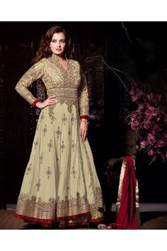 FLAUNT YOUR FASHION INSPIRATION IN THIS OFF WHITE NET HEAVY EMBROIDERY ANARKALI SUIT.