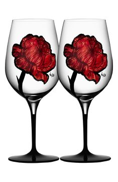 Bright red roses with a distinctive tattoo aesthetic can go either romantic or rock 'n' roll on a pair of wine glasses that hold a toastworthy amount of liquid. They're crafted in Sweden using environmentally friendly paints to enhance any friendly-environment mood. Style Name:Kosta Boda Set Of 2 Tattoo Wine Glasses. Style Number: 6069866. Available in stores. Wine Glass, Glass Art, Malbec Wine, Kosta Boda, Virginia Wineries, Shipping Wine, Free Shipping, Wine Online, Wine And Spirits