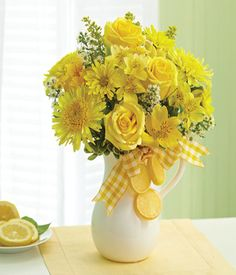 Yellow flowers with a country look.  Would also be pretty in blue vases!