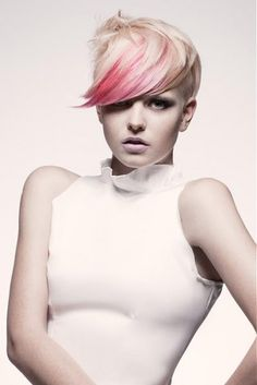 Half shaved pixie hairstyle with side swept fringe