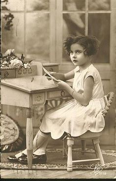 Young girl writing letter (vintage photo)