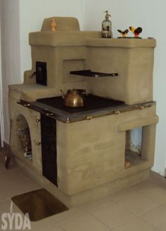 A clay oven by Syda Cob House Plans, Clay Oven, Pizza Oven Outdoor, Cooking Stove, Cottage Pie, Stove Fireplace, Rocket Stoves, Sweet Home, Pizza Ovens