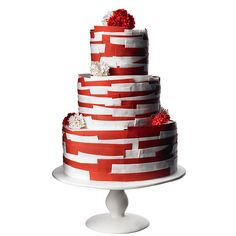Brides.com: 34 Stunning Wedding Cakes for a Winter Wedding. A Red and White Tiered Wedding Cake. A three-tiered cake in a candy cane color-combo, like this one from Maggie Austin Cake, is perfect for a holiday-hued wedding.  See more red wedding cakes.